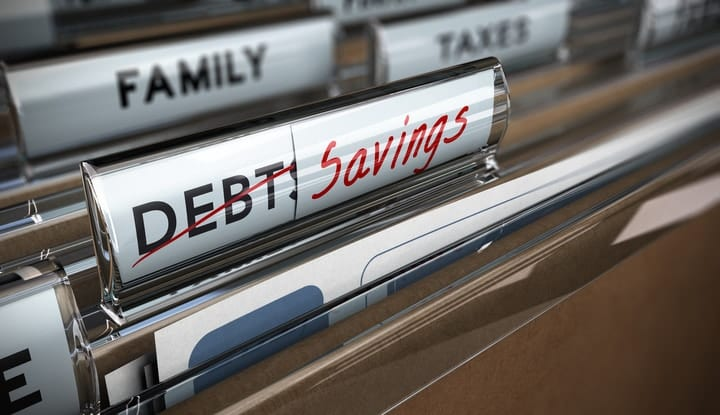saving money or paying off debt