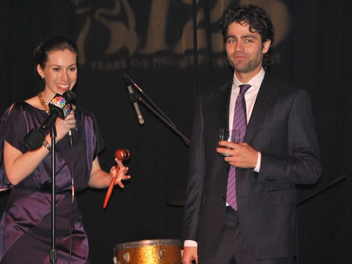 Christie's auctioneer Rachel Orkin Ramey and actor Adrian Grenier attend the Glenfiddich 125th Anniversary event on Liberty Island on March 15, 2012 in New York City.