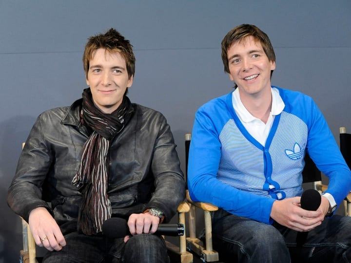 Oliver Phelps and James Phelps visits the Apple Store Soho on April 3, 2011 in New York City.