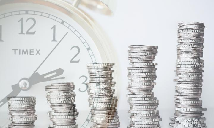 Coins and a clock depicting investment gains over time