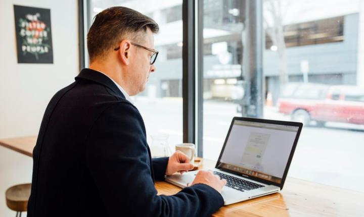 Man in a suit on a laptop