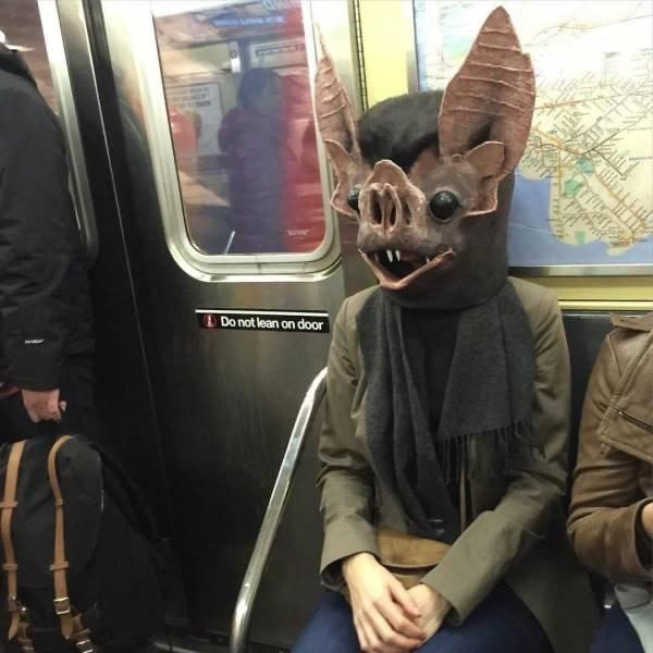 batman, batwoman, bat on the subway