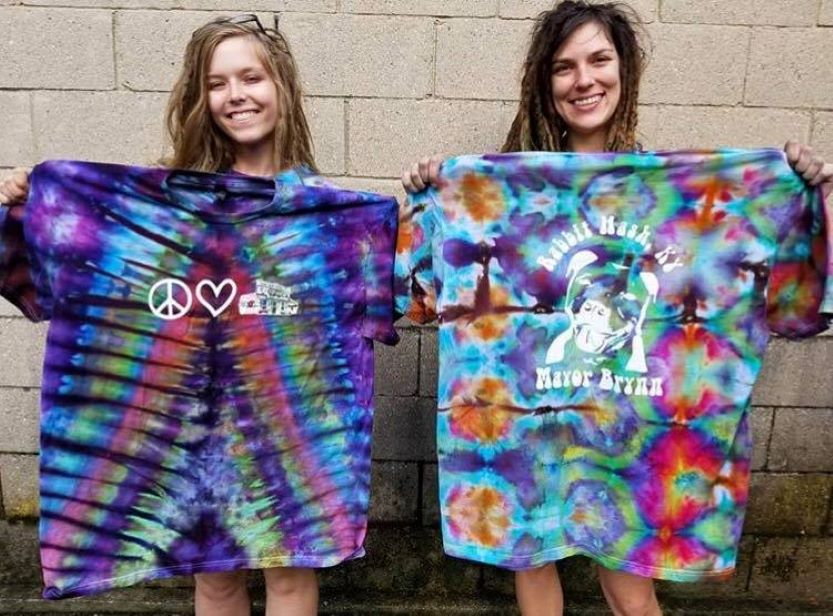 two girls holding t-shirts